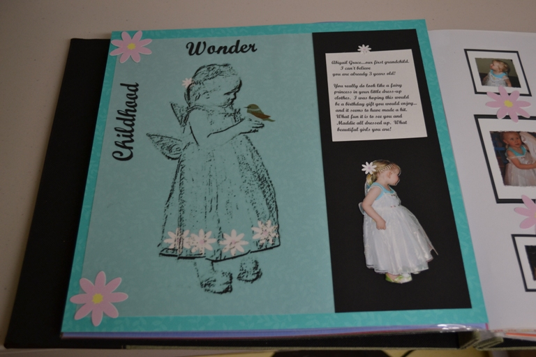 Photo of scrapbook page with finished vellum overlay