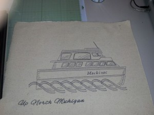 Image of boat sketched on piece of canvas with black pen